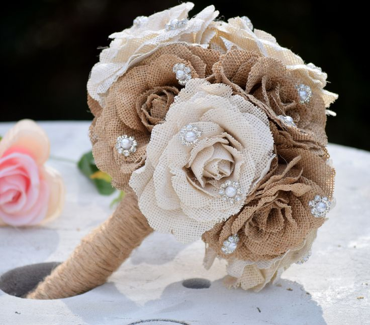 This listing includes 1 large burlap flower bouquet. The bouquet itself is made with 10 burlap flowers. Pictured is 5 in natural and 5 in ivory but this can be done in any combination. These flowers a