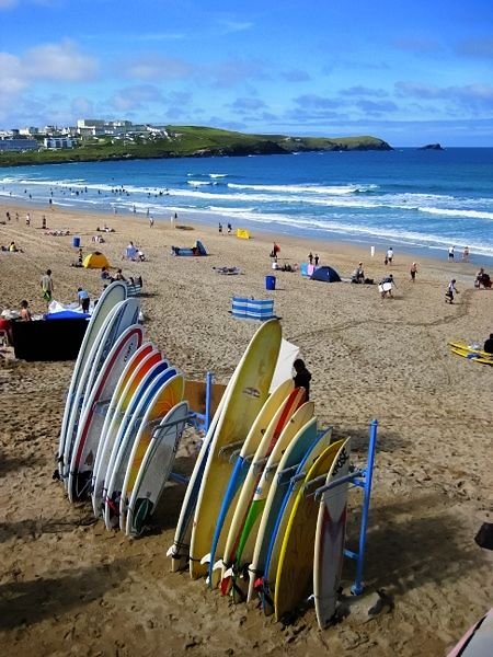 Surfboards line up ready for another day of riding the best waves the Atlantic washes in. Fistral Beach, Newquay