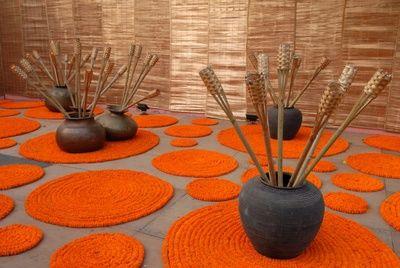 marigold mats , round marigold flowers, earthen pots