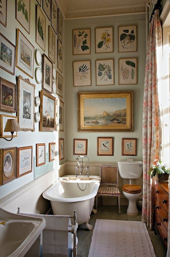 Gold framed botanicals cover a bathroom - gallery art wall with a difference.