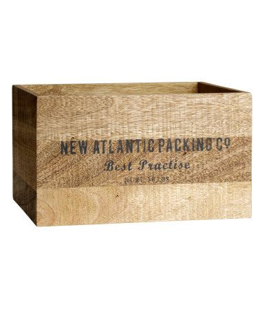 Wooden book with a rustic, antique look. Printed text motif on long sides. Size 6 3/4 x 9 x 11 1/2 in.