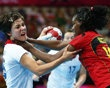 Britain's Marie Gerbron is challenged by Angola's Marcelina Kiala in their women's handball Preliminaries Group A match at the Copper Box venue during the London 2012 Olympic Games ...DOES THIS LOOK LIKE SHE WAS CHALLENGED????