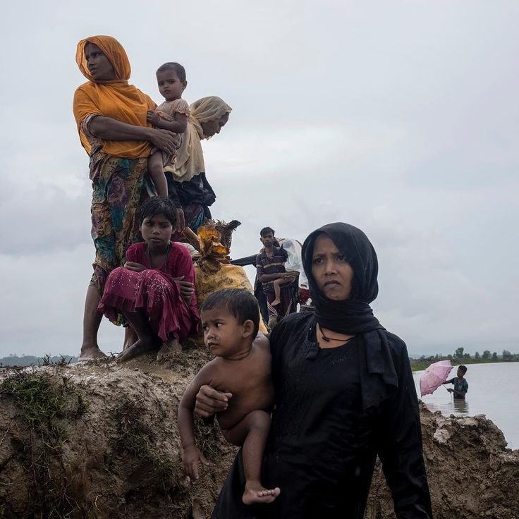 Members of Myanmar's Rohingya ethnic minority walk in flooded land after crossing the border into Bangladesh, Sept. 1, 2017. Photograph by William Daniels (@williamodaniels)—@panospictures