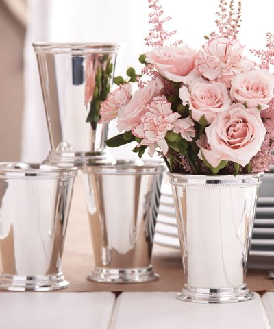Set of 4 Mint Julep Cups in Gift Box - whether she uses them for mint juleps, another drink, or just for decoration, she's bound to find many uses for these beautiful silver cups!