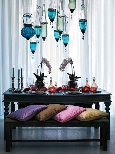 Dining table, cool lamps and lots of pillows #bohemian #indiska