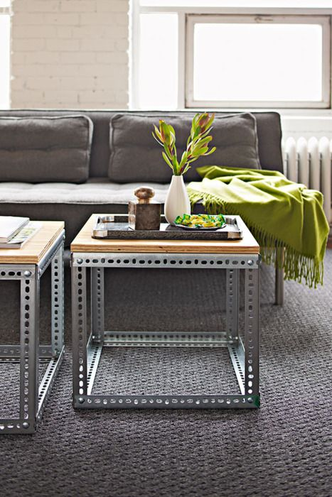 sofa tables made with vertical support bars from old metal shelving and a plywood top.