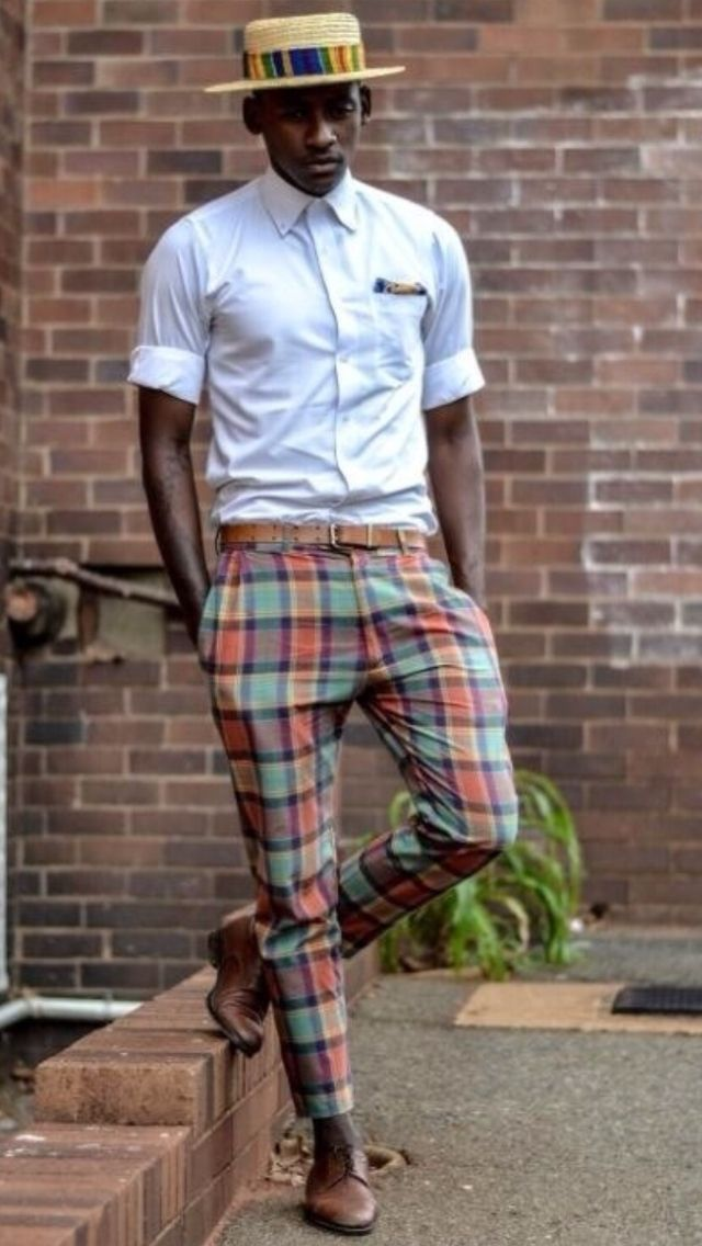Stand out among other stylish civilians in a white oxford shirt and multi colored tartan chinos. Brown leather derby shoes will bring a classic aesthetic to the ensemble.   Shop this look on Lookastic: https://lookastic.com/men/looks/dress-shirt-chinos-derby-shoes-hat-pocket-square-belt/12809   — Brown Leather Derby Shoes  — Brown Leather Belt  — White Dress Shirt  — Multi colored Pocket Square  — Tan Straw Hat  — Multi colored Plaid Chinos