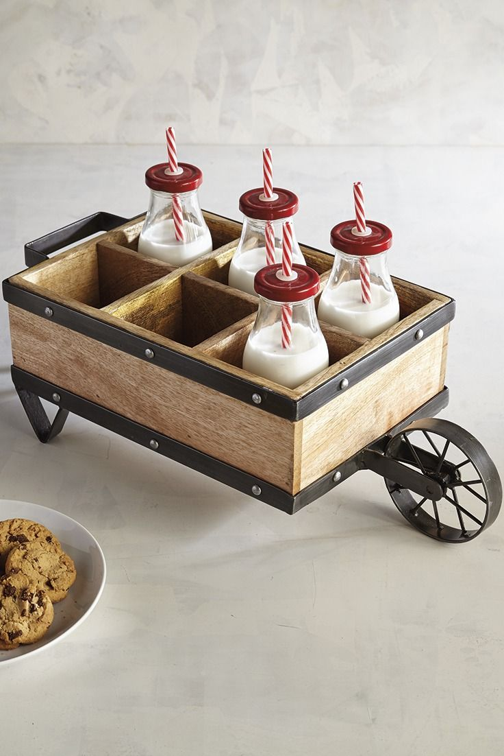 What a way to roll out the barrels—or bottles in this case. Pier 1's Wheelbarrow Bottle Caddy will transport your style in full farmhouse charm or in garden-party pretty just as easily. Crafted of mango wood and edged in iron, it can hold more than just bottles—perhaps a few little pots of faux succulents.