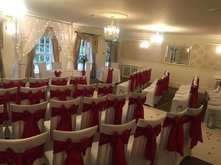 Red wedding chair covers backdrop #lythamwedding #weddinglytham #lythamevents #wedding #lancashireevents #lancashireweddings #chaircovers #christmaswedding www.thelythamweddingcompany.co.uk
