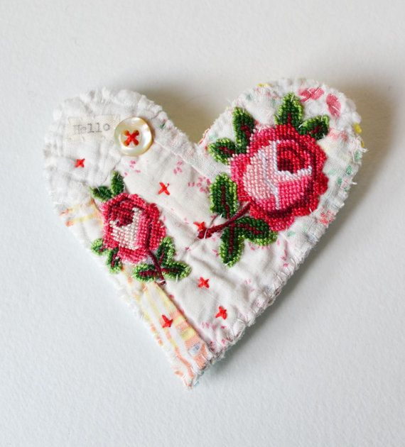 BROOCH Textile heart shaped.  Appliquéd rose trims. Hand stitched.