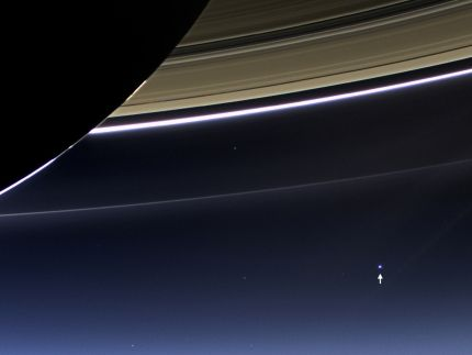In this rare image taken on July 19, 2013, the wide-angle camera on NASA's Cassini spacecraft has captured Saturn's rings and our planet Earth and its moon in the same frame