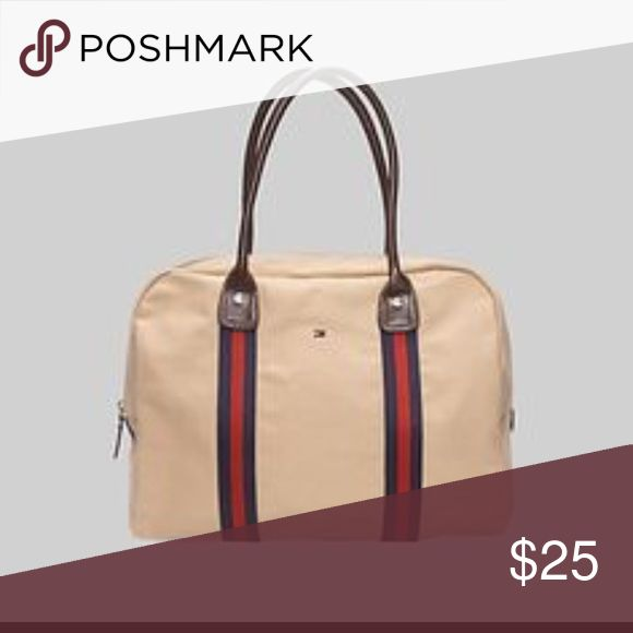 Tommy Hilfiger weekend tote bag Good condition.! Missing the strap of the zipper and the handles have wear but very clean Tommy Hilfiger Bags Totes