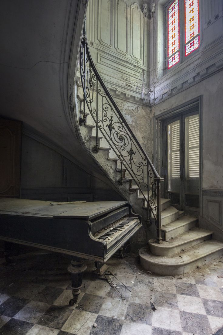 A piano at an abandoned French villa, taken in 2014.