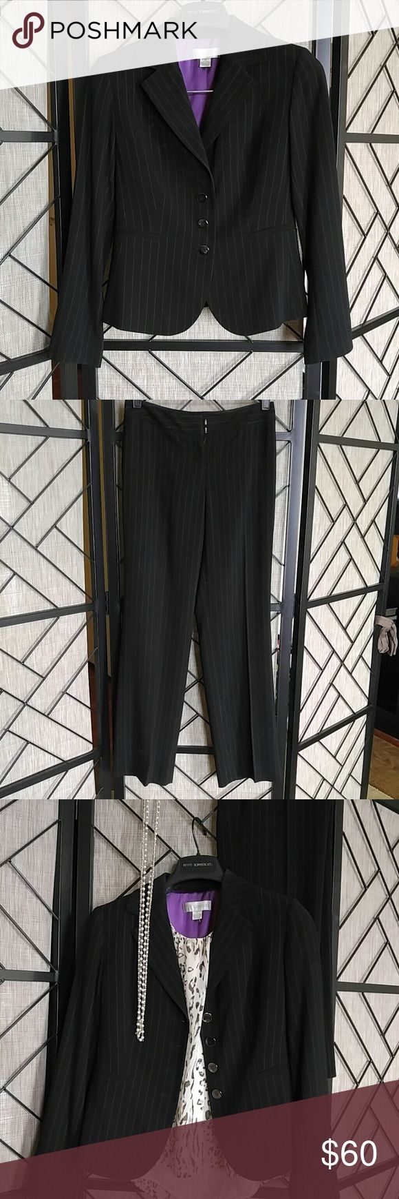 Petite Sophisticate Women's Suit Black suit with subtle pin stripes. 2 front pockets. Blazer and pants are lined. Blazer has small hole not noticeable in the top back, see pic. Overall suit looks great and is in great condition, with the exception of the small nick that would be well hidden if you wore a black or dark shirt under. Petite Sophisticate Other