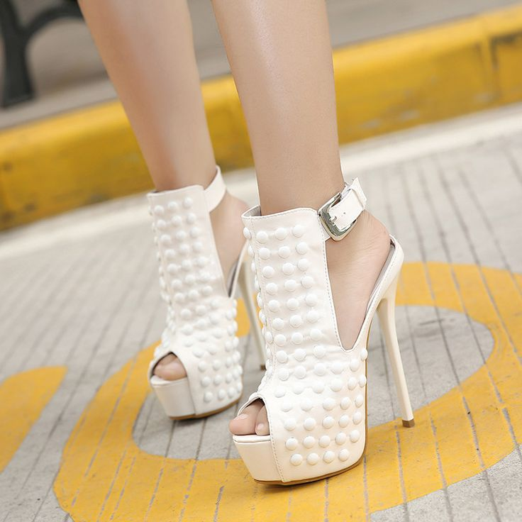 - Edgy peep toe ankle strap high heels for the modern fashionista - Beautiful design and ankle strap offers a trendy unique look - Great for parties and social events - Made from PU - 11 cm heel heigh