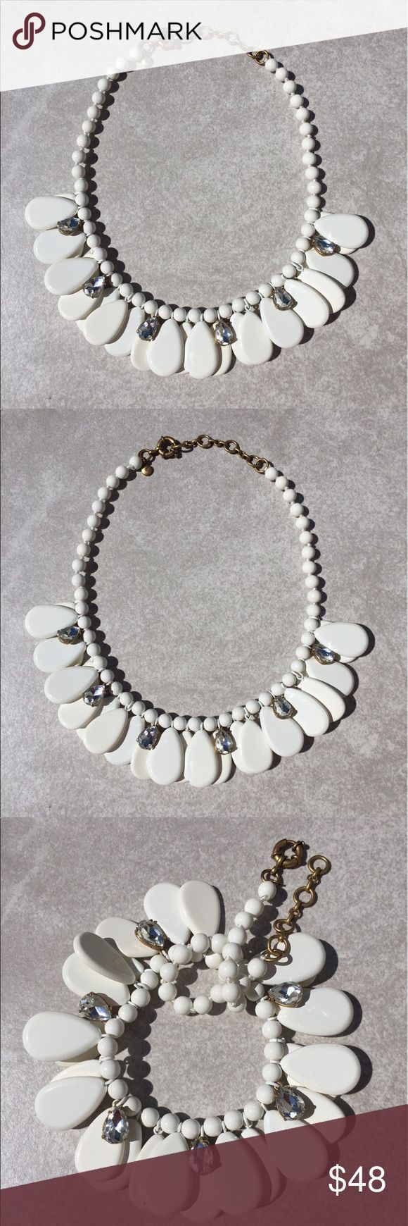 J Crew Necklace J Crew Statement Necklace - white ceramic look petals dangle with clear faceted teardrop shaped crystals draped intermittently in between.  Perfect for Spring and Summer.  Wear with a white tee and jeans 👖 or white linen and heels.  Very pretty!  Tiny tiny nick on one in of the petals (see pics) not noticeable ( just letting you know).  This is not a J Crew Outlet item.  Purchased in J Crew store from under the glass and worn once. J. Crew Jewelry Necklaces