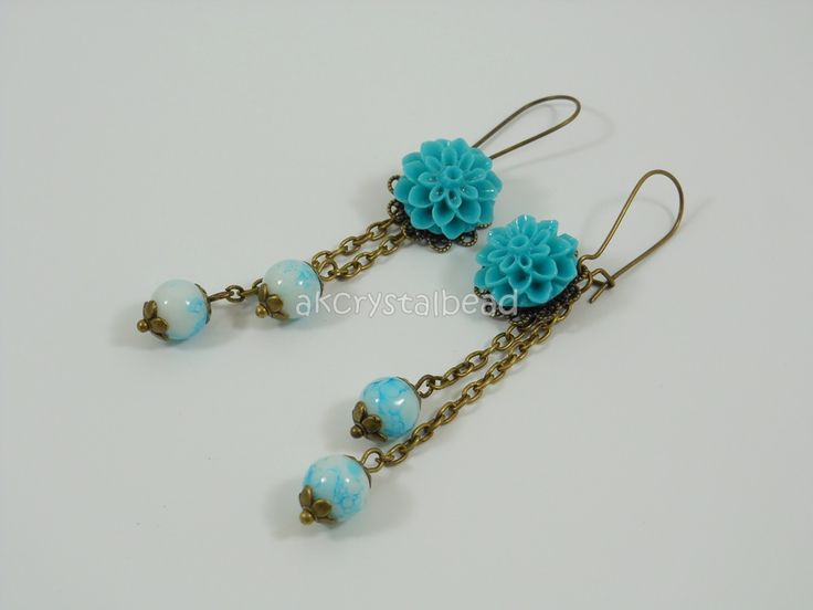 Blue flower cabochon and blue glass bead earrings. BGT0030