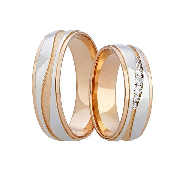 Přepychové snubní prsteny z bílého zlata, jejichž snížené boky a elegantní matná vlnovka jsou vyvedeny ve zlatě červeném. Do dámského kroužku je vsazeno sedm kamenů čtyř velikostí.