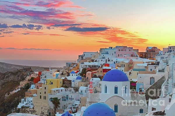 #Oia, traditional greek village of #Santorini, with blue domes of churches at sunset, #Greece by Anastasy Yarmolovich #AnastasyYarmolovichFineArtPhotography #travel