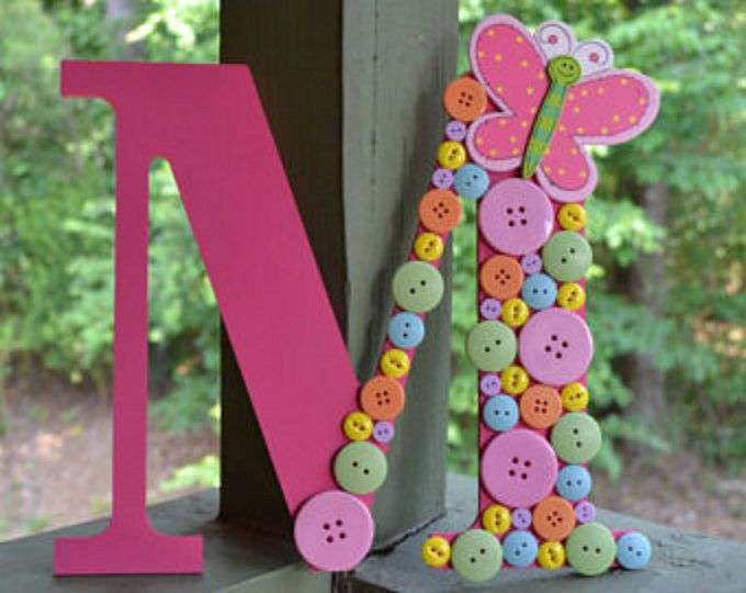 This is a 9 1/2 inch wooden letter A that is painted purple and covered with pastel buttons. It would look perfect in a babys nursery or even a girls room. This would also make a cute photo prop! If you would like something custom ordered please message me what letter or number you would like and what color buttons you want. Please allow 7-10 business days for custom orders. I can also make a 13 inch one for $5 more.