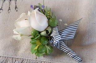 Save on the florist bill by making your groom's boutonniere at home: | 24 DIY Decorations That Will Make Any Wedding Look Like A Million Bucks