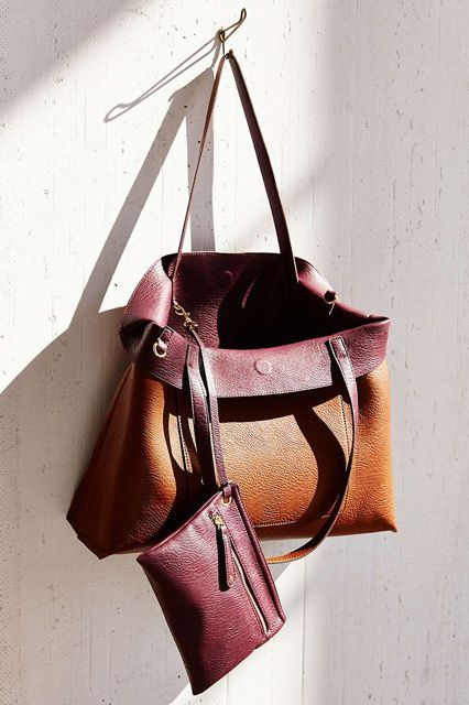 A reversible tote is really the best two-for-one deal around. This one lets you pick either a classic brown finish or a more playful aubergine hue. And, bonus! The extra pouch is detachable, so you can carry it solo as a clutch. #refinery29 http://www.refinery29.com/best-tote-bags#slide-9