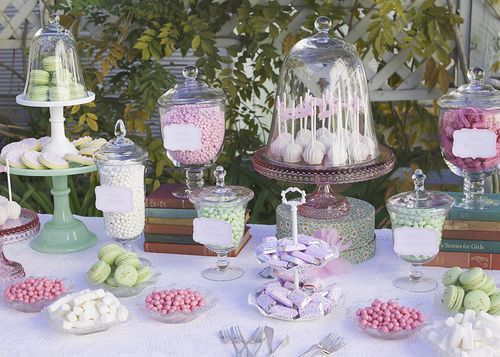 This is similar to what we did at our Mad Hatter's tea party... with a collection of tea pots of flavored teas mixed in.