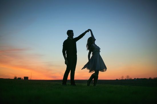 couple dancing as the suns sets