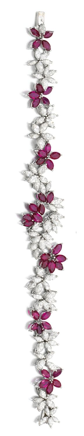 RUBY AND DIAMOND DEMI-PARURE Comprising: a necklace and bracelet each set with marquise-shaped rubies and diamonds, necklace length approximately 445mm, bracelet length approximately 185mm, Dutch assay marks.