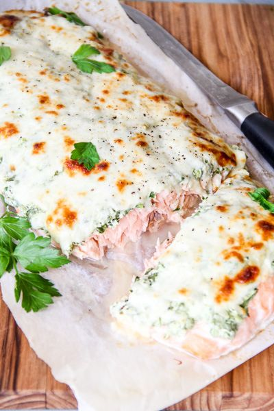 Delicious baked salmon topped with Chobani Greek Yogurt, spinach and cheese.