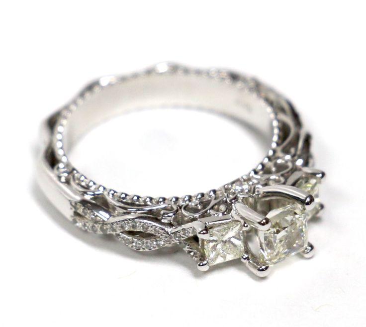 Three brilliant princess diamonds set in an elegant white gold band. Find it on WhiteCarat.ca!
