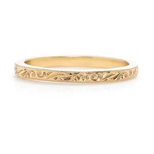 Featuring intricate hand-engraving, this yellow gold band is the perfect for a woman who wants something simple, yet stunning.