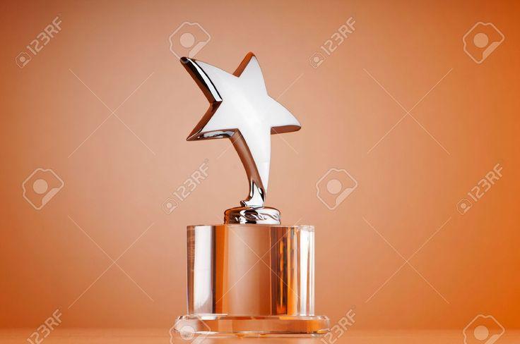 9716555-Star-award-against-gradient-background-Stock-Photo-trophy.jpg (1300×863)