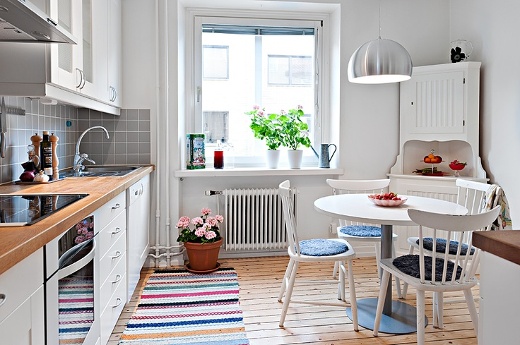 Scandinavian kitchen. love the bright white and corner cabinet