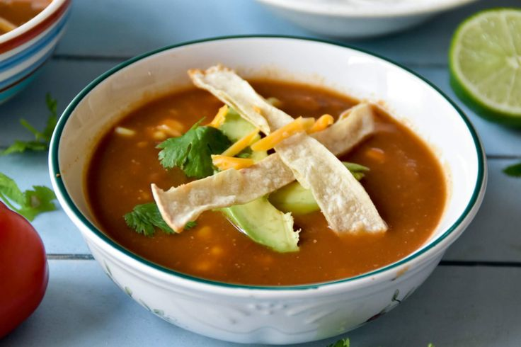 Delicious Vegetarian Tortilla soup with lot of veggies, pinto beans and corns, used baked tortilla chips instead fried ones.