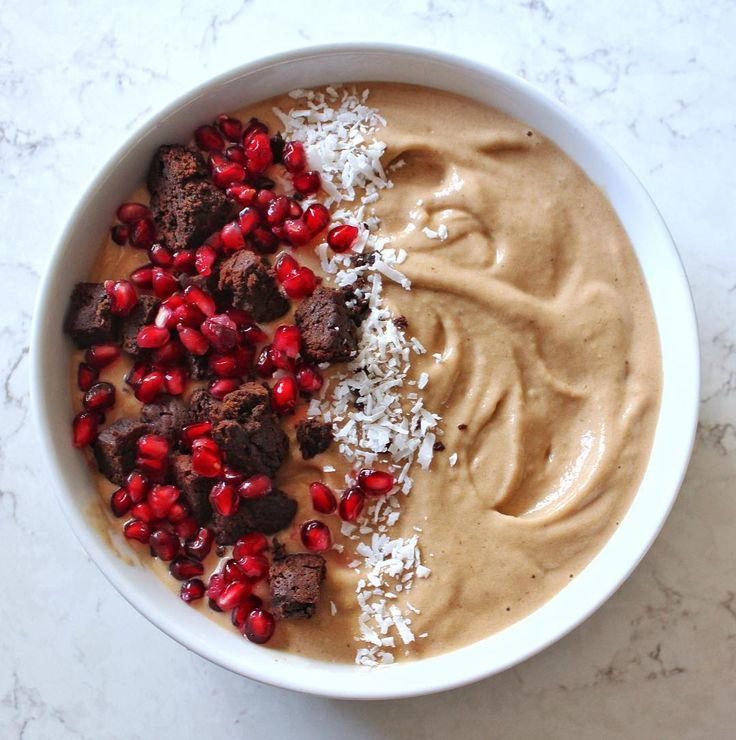 Blending + Baking = this BEAUTIFUL chocolate peanut butter smoothie bowl  topped with healthy brownie bits from Candice Lynn Fit Vegan !    Not only does this recipe use PBfitⓇ, but to whip up the black-bean brownies she used our organic cacao & coconut palm sugar!  Healthy recipe magic! ✨