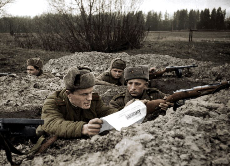 At the forefront in the trenches,The sergeant reads to the fighters a fresh issue of the newspaper 1943