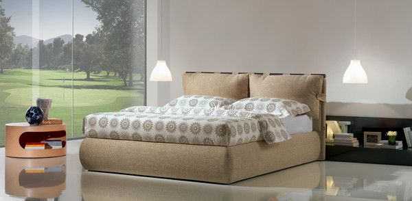 "Upholstered bed with a ""plus"" storage base internal height 25 cm by Oggioni. Available in different colours.  With an elegant and modern design, the bed Premium Dual is characterized by straight and sinuous shapes able to fit any house.  Dimensions: height 101 cm; width 210 cm; depth 187 cm. https://www.livingfurnish.co.uk/collections/bedroom/products/premium-dual-bed"