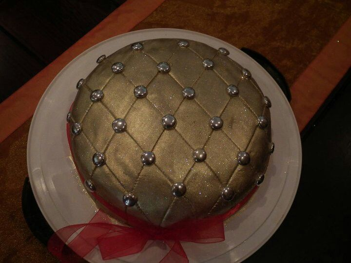 Gold cake with large silver buttons