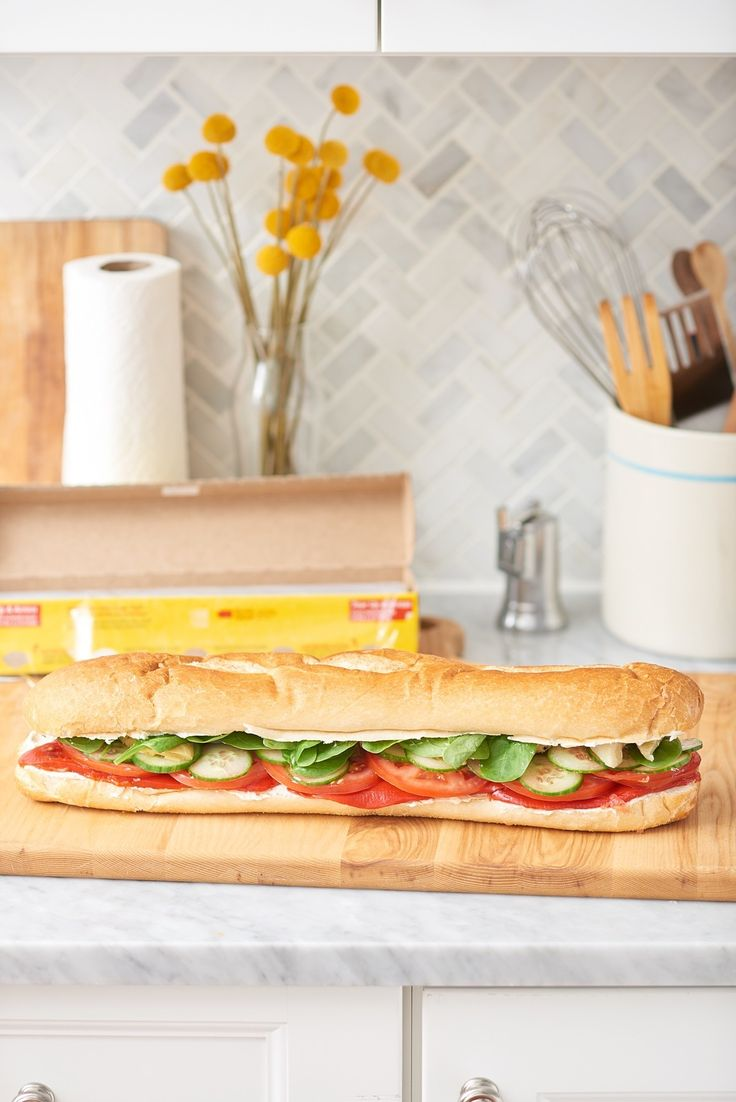 """A cold sub for Summer is the perfect """"to go"""" lunch. This healthy travel-friendly sandwich recipe is jam packed with vegetables and garlic cream cheese"""