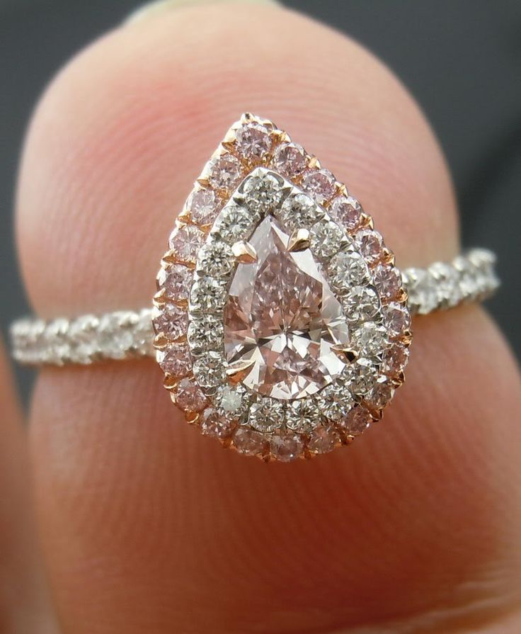Light pink diamond pear shaped engagement ring with double halo.