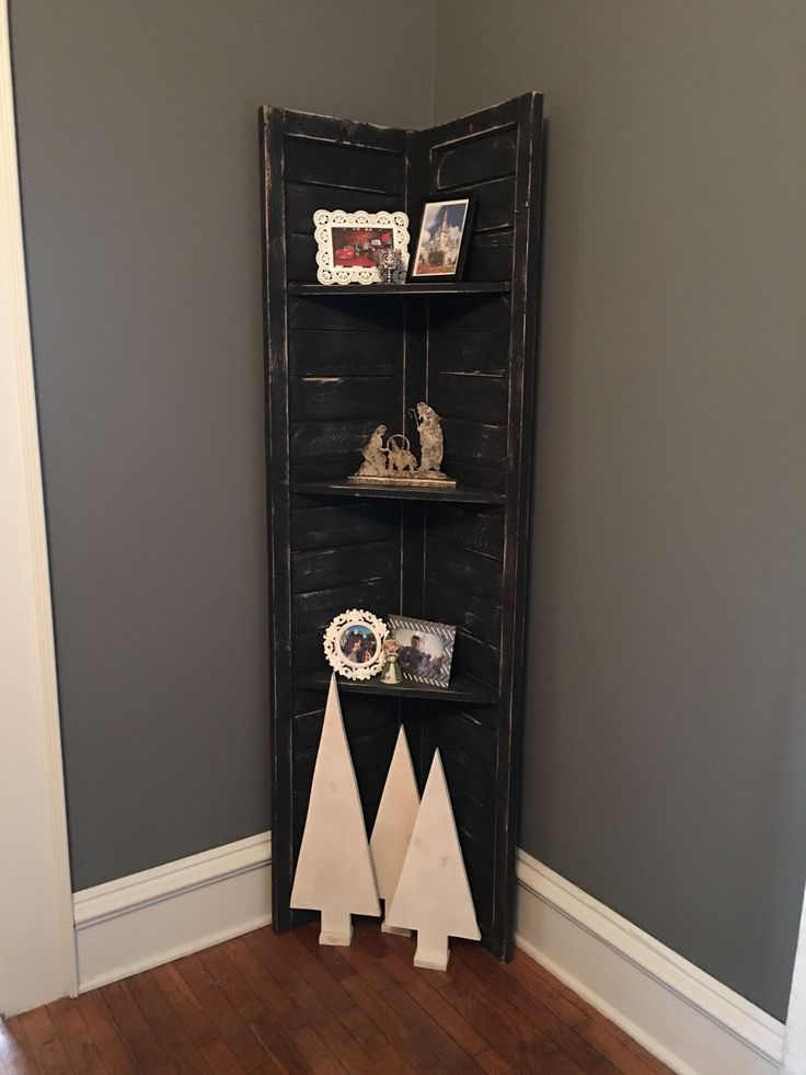 Old large shutters repurposed into a corner shelf