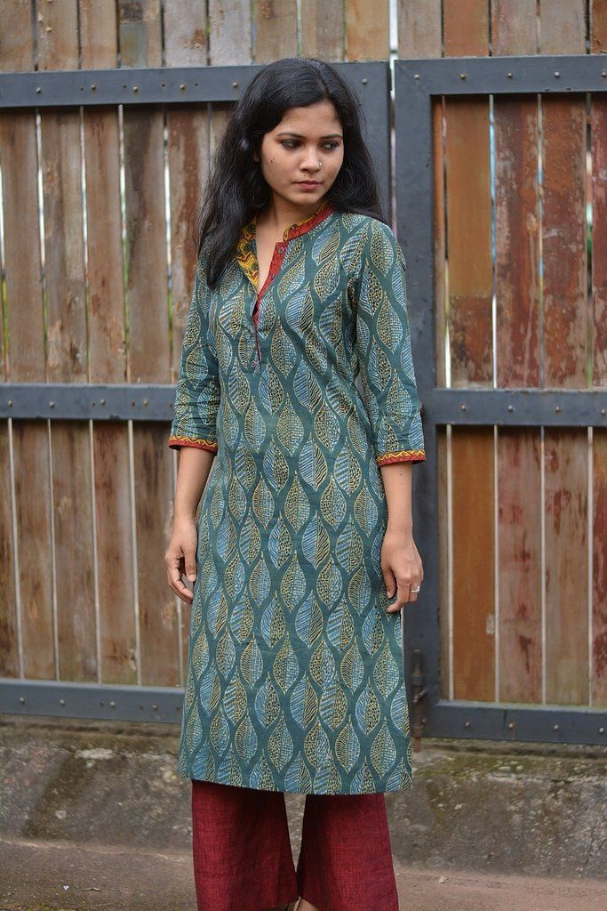 Green Ajrakh kurta with double collar and sleeve detail Hand block printed Three-fourth sleeves. Pure cotton. Hand wash only