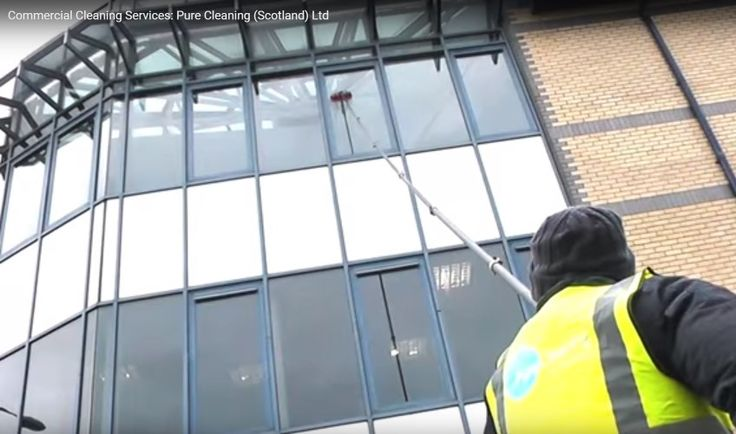 Reliable and superior office window cleaing services by Pure Cleaning (Scotland) Ltd. Cleaning office windows with deionized water and water fed pole .