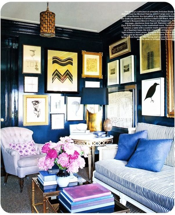 Lacquered dark walls. Great wall of art. blue & pink. Light & dark blue conveys trust/truthfulness while pink is the color of pure love