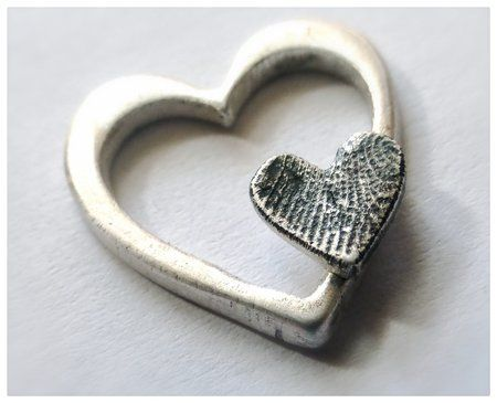 Fingerprint jewellery, handmade in fine silver. This was a make for myself I absolutely love my fingerprint necklace.nn19/05/2015 15:14