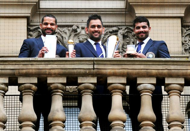 Team India : Dhawan, Dhoni and Jadeja at a photocall in Birmingham on Monday.   Winners of 2013 Champions trophy Cricket