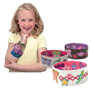 "Design Your Own Bracelets - Fashion activity set lets kids make their own accessories to wear and share! Exciting craft kit includes 4 double-sided bracelets, with a different colour on each side, plus over 100 sparkle-gem and glitter stickers to decorate with. Each bracelet has a reusable tab closure, and measures 7-1/2""L x 1""W. Ages 4+. (Product Number MD4217) $7.98 CAD"