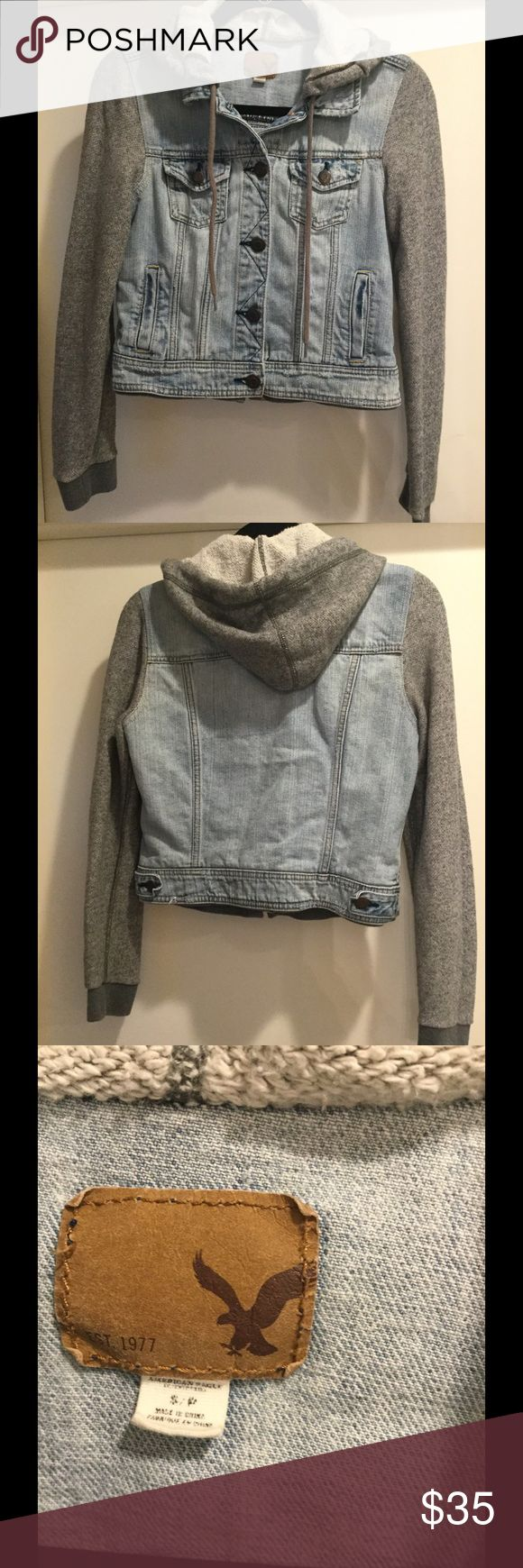 American Eagle 🦅 Jean jacket w/ Hoodie Size S Really cute Jean jacket with grey hoodie and grey sleeves. Size S. It does have a small hole on Hoodie but when drawstring is pulled it is not visible. 100 % cotton. Copper colored buttons. Good condition. American Eagle Outfitters Jackets & Coats Jean Jackets