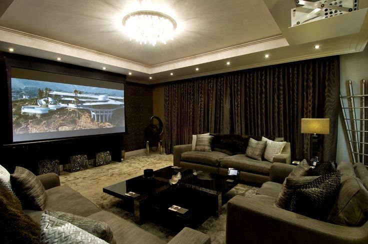 Clever and hide-able adaptations to the living room, meaning it now becomes a spectacular cinema at the touch of a button.
